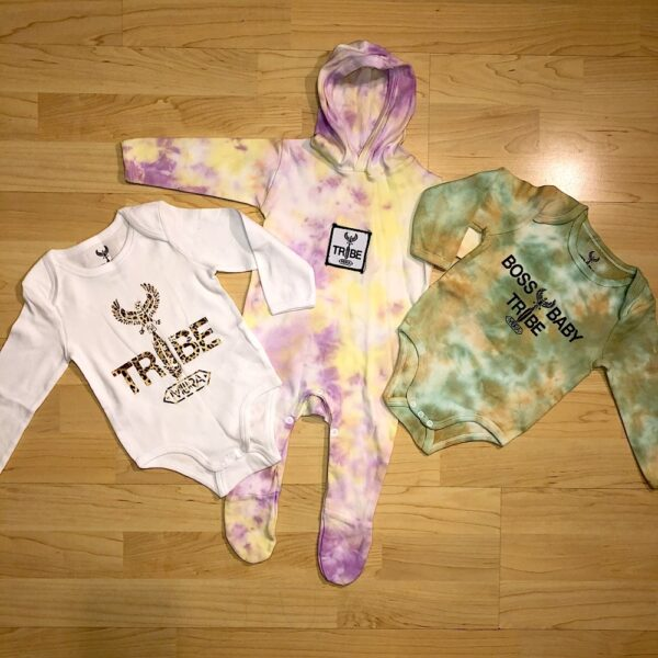 Baby onesies with a tie dye design.