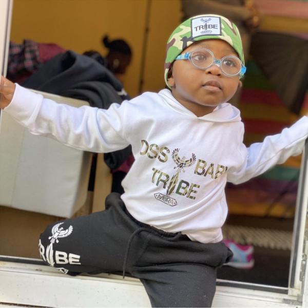 Black Baby Boy wearing a camouflage print Tribe patch Bandana