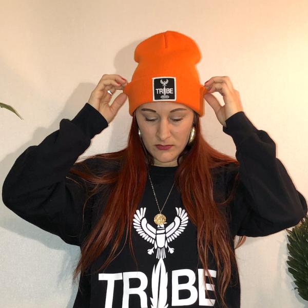 A bright orange beanie hat