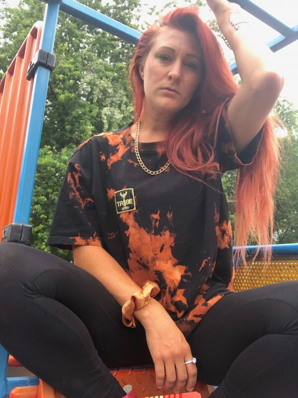 Oversized cotton bleach dye t-shirt. black oversized t-shirt with orange patterns from bleach dying.