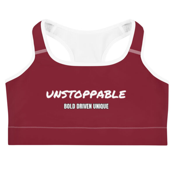 """Deep red sports bra with a white print saying """"Unstoppable, bold brave unique"""""""
