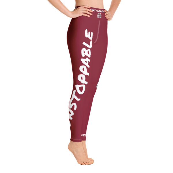 Redwine red high waisted yoga leggings with a white print saying unstoppable