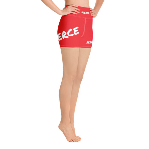 Red gym shorts with a white print saying fierce