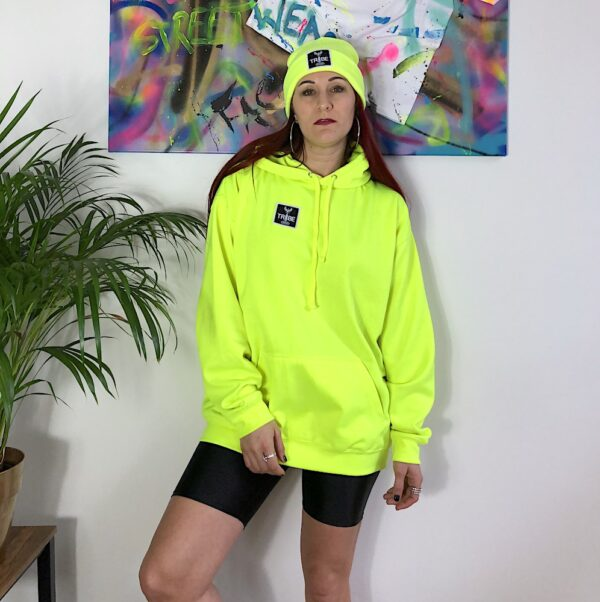 Yellow Neon Hoodie with a small black and white TRIBE patch on the right side front.